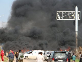 A picture taken on April 15, 2017, shows smoke billowing following a suicide car bombing in Rashidin, west of Aleppo, that targeted buses carrying Syrians evacuated from two besieged government-held towns of Fuaa and Kafraya. At least 40 people were killed in a suicide car bombing near buses carrying Syrians evacuated from two besieged government-held towns, the Syrian Observatory for Human Rights said.  / AFP PHOTO / Ibrahim YASOUF        (Photo credit should read IBRAHIM YASOUF/AFP/Getty Images)