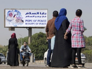 A billboard welcomes Pope Francis, in Cairo, Egypt, Thursday, April 27, 2017. On Friday, Francis is scheduled to begin a two-day pilgrimage to Egypt aimed at lifting the spirits of Christians in the Middle East, whose numbers have rapidly dwindled in recent decades due to war, displacement and emigration. The visit will include a meeting with Egypt's president and the Grand Imam of Al-Azhar as well as a Mass in a stadium on the outskirts of Cairo. (AP Photo/Amr Nabil)