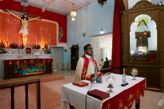 An Indian Catholic Priest delivers his sermon during a special mass at Sister Alphonsa's church in Mala, in the southern Indian state of Kerala on October 11, 2008. Christians are gearing up to celebrate the canonization by Pope Benedict XVI of the young Roman Catholic nun Alphonsa who once disfigured herself to avoid marriage, some sixty years after her death. AFP PHOTO/RAVEENDRAN / AFP PHOTO / RAVEENDRAN