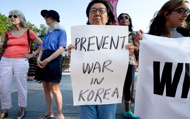 Nuclear war protesters demonstrate outside the White House in Washington Aug. 9. Church officials called for dialogue to ease U.S.-North Korea tensions. (CNS photo/Tyler Orsburn) See US-KOREA-TOMASI and US-KOREA-DIPLOMACY Aug. 10, 2017.