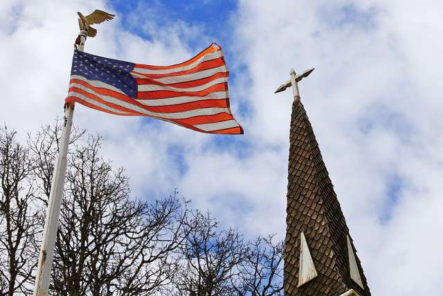 American_flag_and_Church_Credit_Bobkeenan_Photography_via_wwwshutterstockcom_CNA_3_1_16