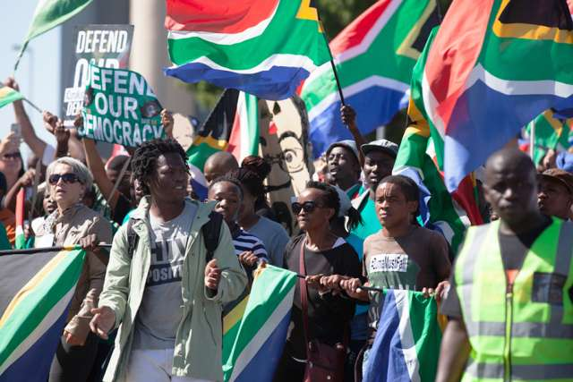 Protesters_march_to_parliament_in_protest_at_President_Jacob_Zuma_Credit_Aqua_Images_Shutterstock_CNA