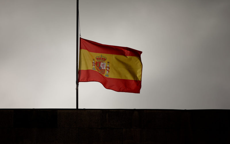 SANTIAGO DE COMPOSTELA, SPAIN - JULY 28: A Spanish flag flies at half mast on top of Santiago First Court building while preliminar judge Luis Alaez is asking for declaration to Jose Garzon Amo, Santiago high speed train crash driver, on July 28, 2013 in Santiago de Compostela, Spain. The high speed train crashed after it derailed on a bend as it approached the north-western Spanish city of Santiago de Compostela at 8:40pm on July 24th. At least 78 people have died and a further 131 are reported injured. The crash occurred on the eve of the Santiago de Compostela Festivities. The train driver, Garzon Amo, has been formally accused of reckless homicide and remains in custody awaiting an appearance in court. (Photo by Gonzalo Arroyo/Getty Images)