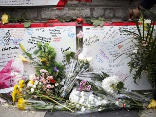 Memorial_for_victims_of_crash_on_Yonge_St_at_Finch_Ave_in_Toronto_Canada_Credit_Cole_Burston_Getty_Images_CNA_1