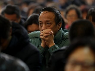 A man prays during a 2017 Mass at the Cathedral of the Immaculate Conception in Beijing. As rumors fly of an imminent Vatican-China deal on the appointment of bishops, a Belgian priest known as an expert on China said he thinks an agreement might really happen. (CNS photo/Wu Hong) See CHINA-DEAL-HEYNDRICKX March 21, 2018.