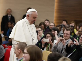 Pope Francis prepares to take a photo with young people at a presynod gathering of youth delegates in Rome March 19. The Vatican has released the working document for the October Synod of Bishops on young people, the faith and vocational discernment. (CNS photo/Paul Haring) See SYNOD-YOUTH-DOCUMENT June 19, 2018.
