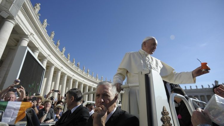 Pope Francis arrives in St. Peter's for the General Audience 14