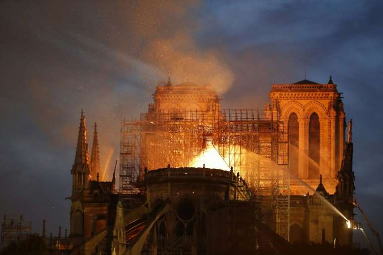 Firefighters_douse_flames_billowing_from_the_roof_at_Notre_Dame_Cathedral_in_Paris_April_15_2019_Credit_Francois_Guillot_AFP_Getty_Images