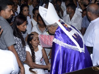 Common Funeral Service for Easter Sunday Victims at  St. Sebastian's Church in Katuwapitiya, Negombo (Sri Lanka) on 23.04.2019: Malcolm Cardinal Ranjith, the Archbishop of Colombo, presided over a funeral service for a group of victims at 10.00am at the church premises. The coffins were brought to the premises one at a time for the services amidst intense security. Funeral services and the burials took place in an atmosphere of heavy grief and sorrow with relatives and friends weeping and mourning for the unexpected loss of their loved ones. Photo: Malcolm Cardinal Ranjith offered a message of consolation to the faithful gathered and invited the faithful to not give into violent retaliation