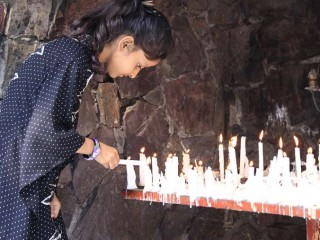 A_young_girl_lights_a_candle_at_a_Marian_Grotto_in_Pakistan_Credit_Magdalena_Wolnik_CNA_12_17_14