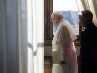 Pope_Francis_looks_out_a_window_of_the_apostolic_palace_March_18_2020_Credit_Vatican_Media