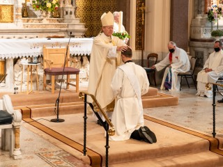 Fr-Ryan-Is-anointed-by-Archbishop-Eamon-Martin