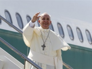 Pope Francis waves as he boards a plane on his way to South Korea, at Rome's Fiumicino international airport, Wednesday, Aug. 13, 2014. Pope Francis is leaving for a five-day visit to South Korea marking the first time in a quarter-century that a pope has been on the divided Korean peninsula. Francis plans to bring a message of peace and reconciliations to Koreans on both sides of the 38th parallel, while encouraging Catholics in the region to spread their faith.  (AP Photo/Riccardo De Luca)